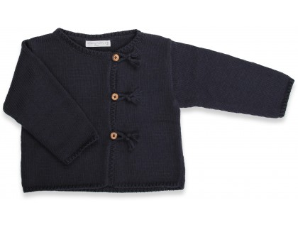 Navy blue baby cardigan knitted in stockinette stitches made from cotton and cachemire