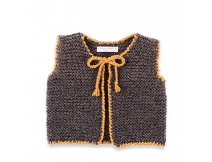 Sleeveless cardigan for baby made from 100% wool. Dark grey color and yellow.