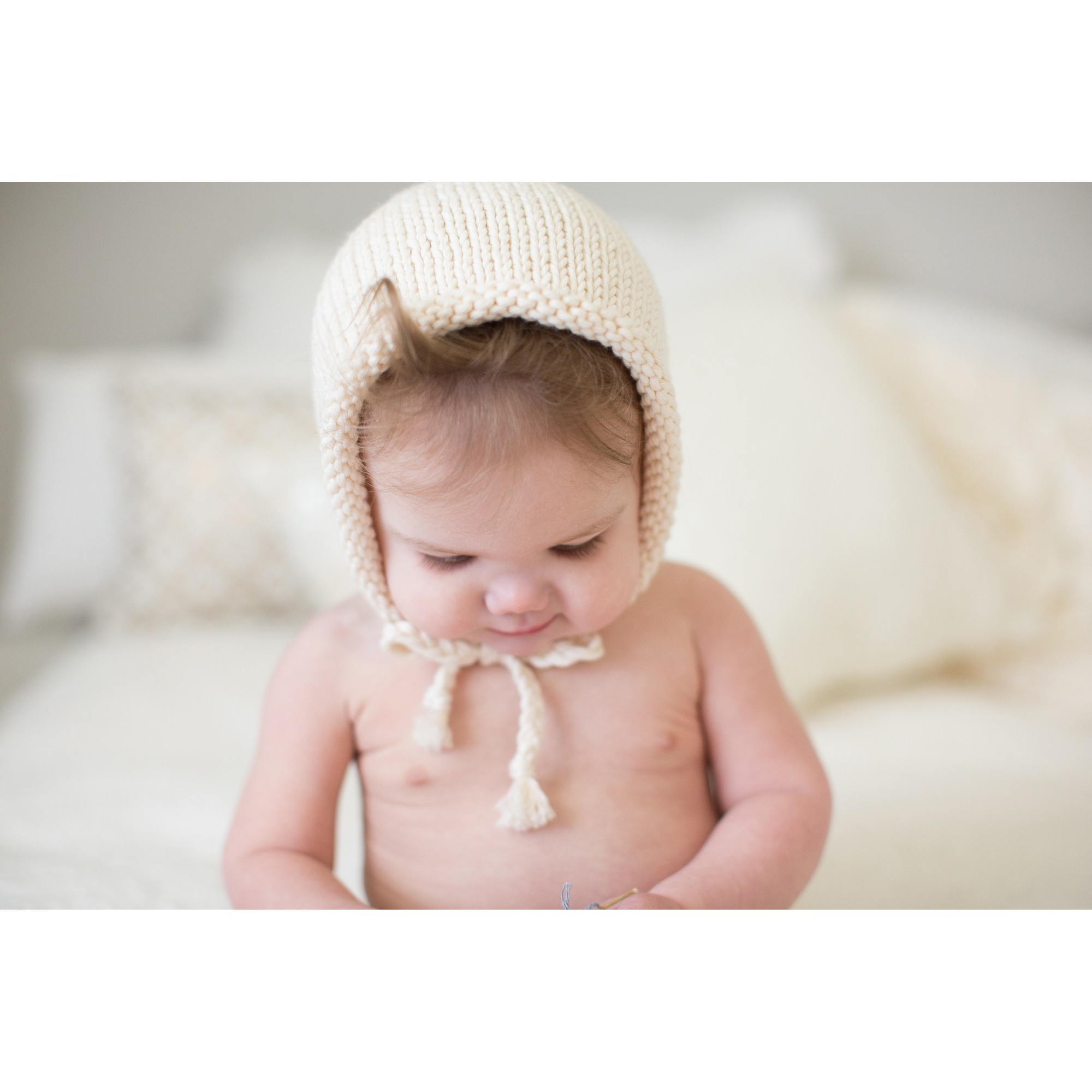 Natural white Germain Bonnet worn by a baby