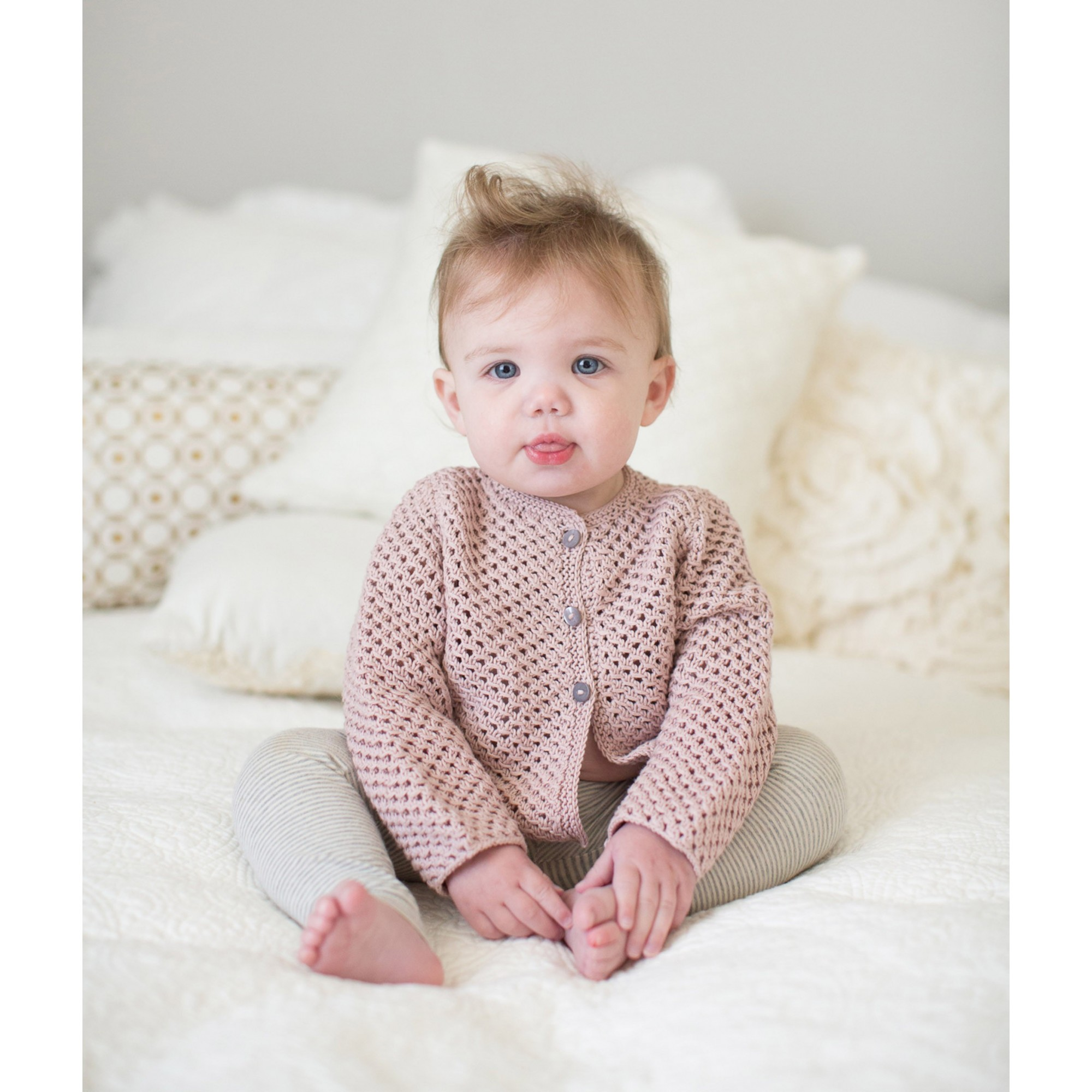 Joséphine cardigan for baby - opaline pink color - worn