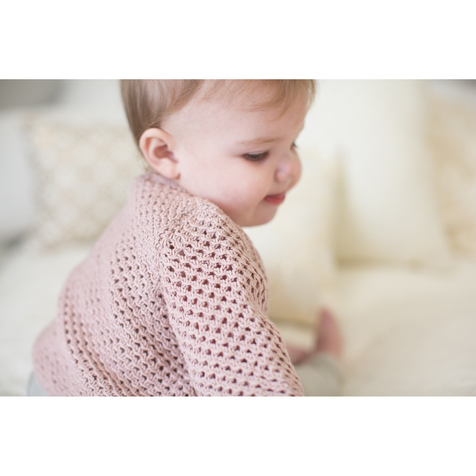 Joséphine cardigan for baby - opaline pink color - worn (other view)