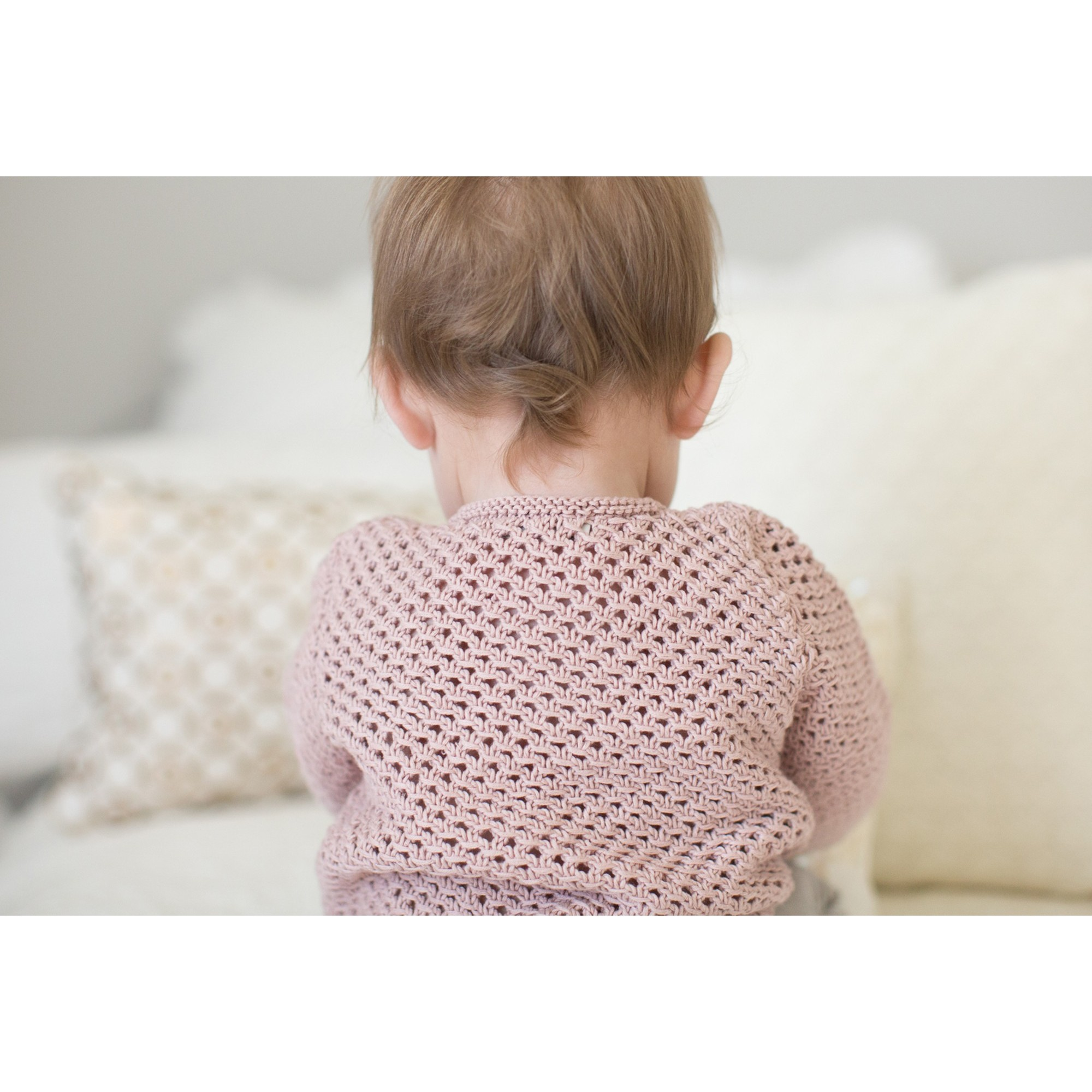 Joséphine cardigan for baby - opaline pink color - worn (seen from the back)