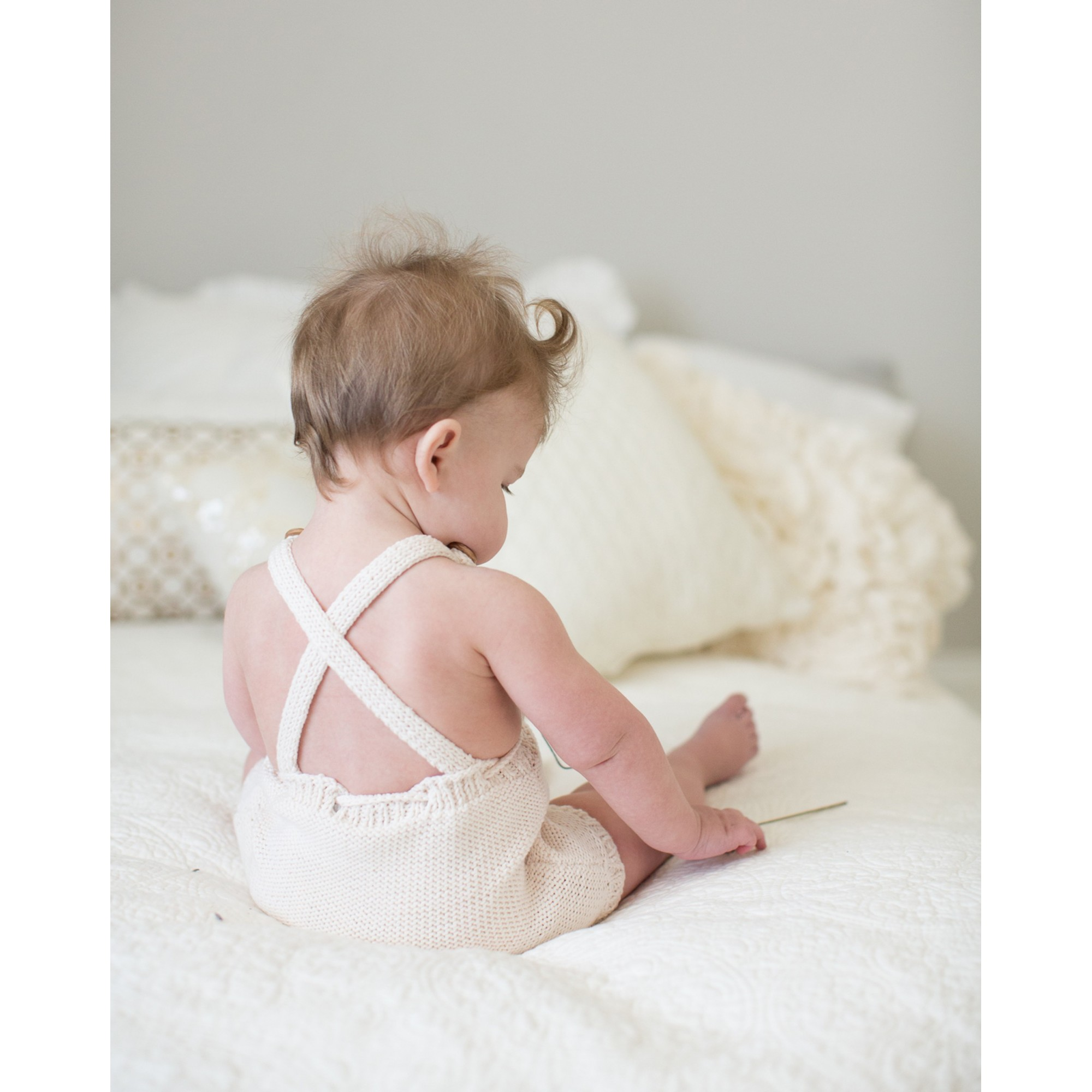 Félicie rompers for baby made from cotton - natural white color - worn (seen from the back)