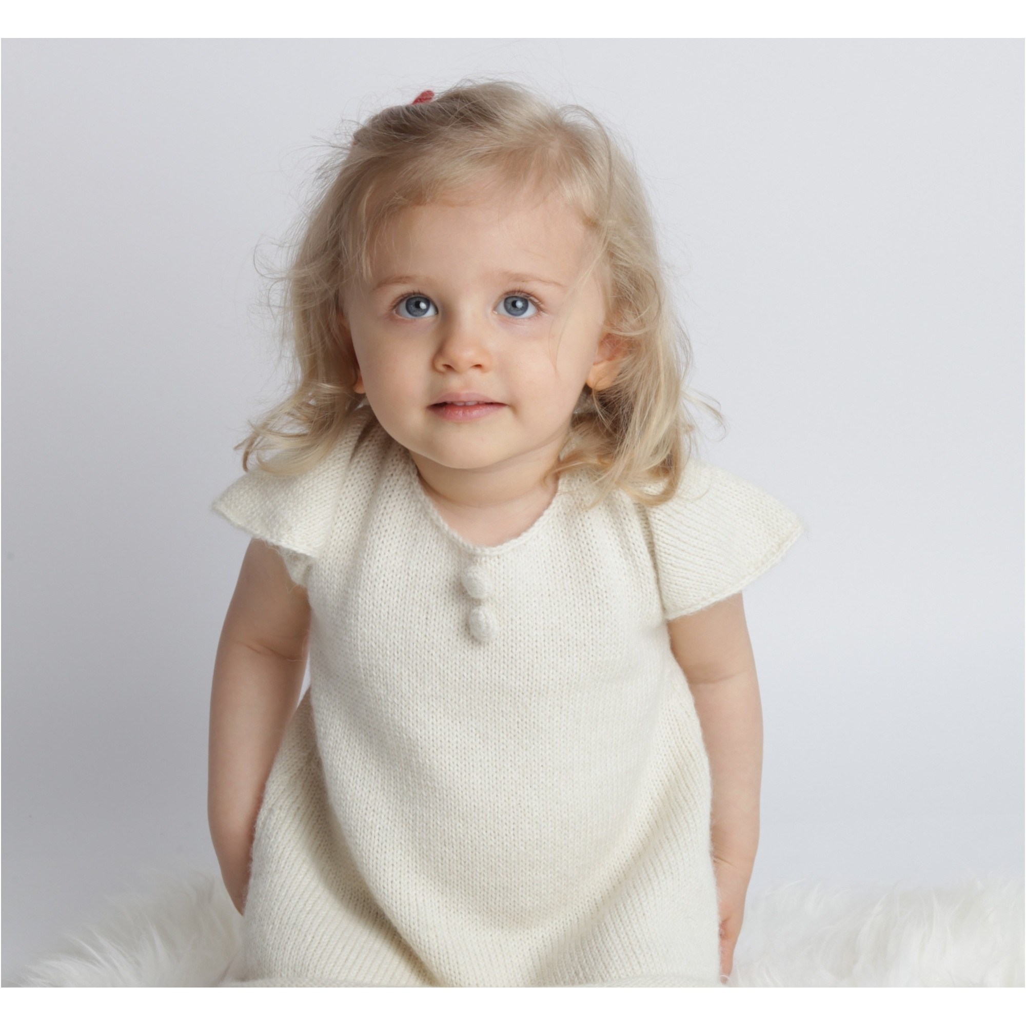 Baby Dress with short and butterfly shaped sleeves made from 100% alpaca natural white