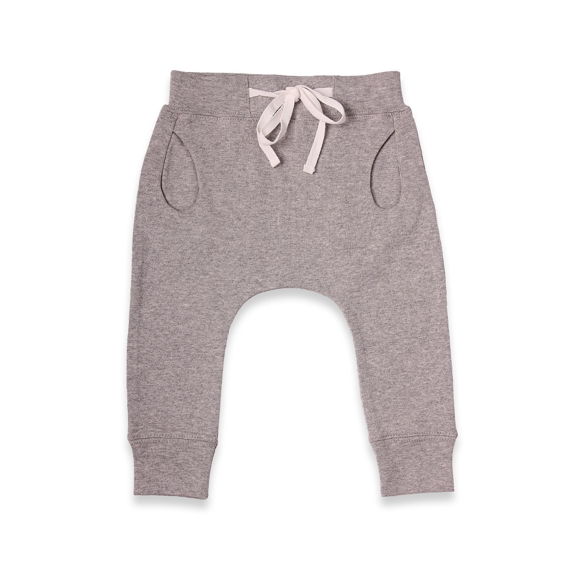 Grey jogging pants with a sarouel shape. Made from 100% pure coton jersey. Elasticated waist and cotton twill band