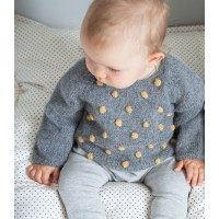 Eugène sweater worn (grey color with knitted honey colored bobbles)